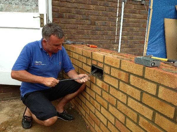 Electrical supervisor paul installing brick lighting on a conservatory in Stevenage.
